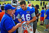 Gator LS Drew Harris signs a fan for a smiling Gator fan.  Florida Gators Spring Practice 2014.  March 26st, 2014.  Gator Country photo by David Bowie.