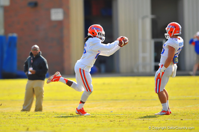 DB Marcell Harris sprints to make the grab during a defensive backs drill.  Florida Gators Spring Practice 2014.  March 26st, 2014.  Gator Country photo by David Bowie.