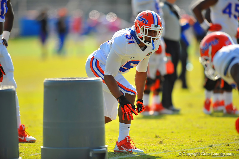 Gator LB Michael Taylor lines up for a defensive drill.  Florida Gators Spring Practice 2014.  March 26st, 2014.  Gator Country photo by David Bowie.