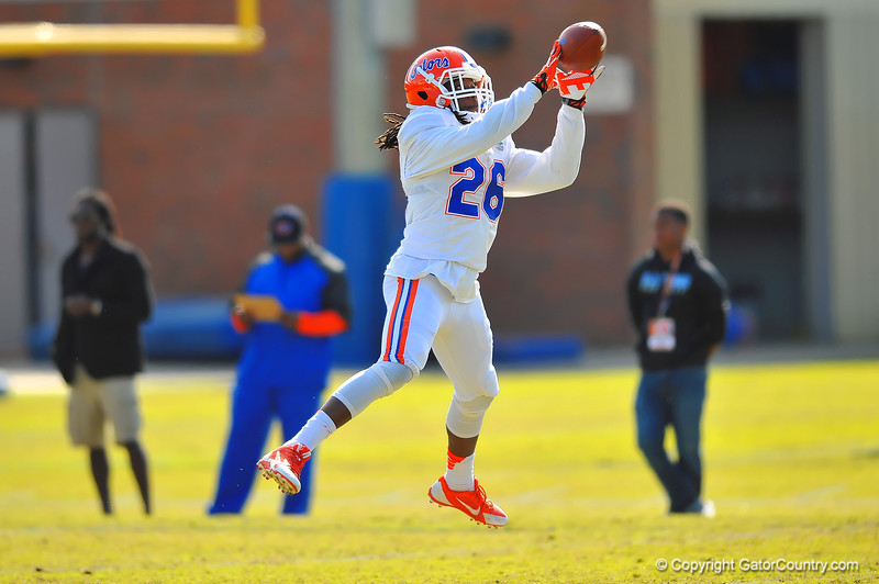 DB Marcell Harris leaps into the air to make the catch during a defensive drill.  Florida Gators Spring Practice 2014.  March 26st, 2014.  Gator Country photo by David Bowie.