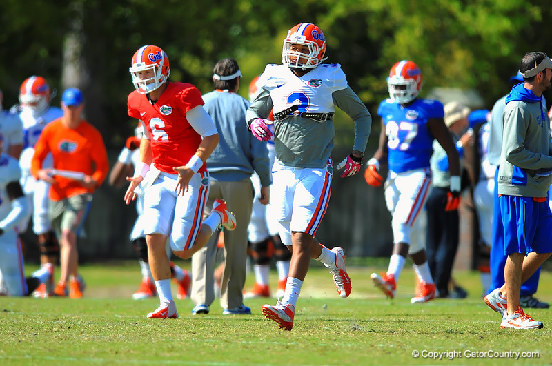 LB Antonio Morrison sprints during warm ups.  Florida Gators Spring Practice 2014.  March 26st, 2014.  Gator Country photo by David Bowie.