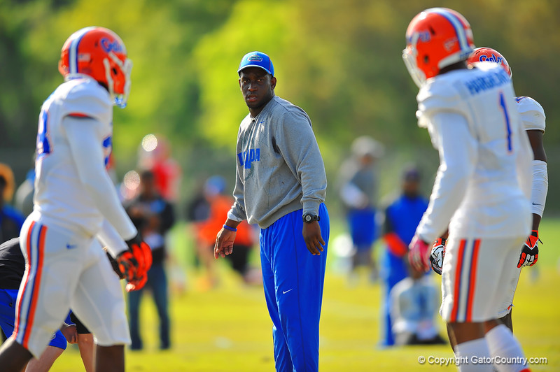 Gator defensive backs coach Travaris Robinson works with his group during practice.  Florida Gators Spring Practice 2014.  March 26st, 2014.  Gator Country photo by David Bowie.