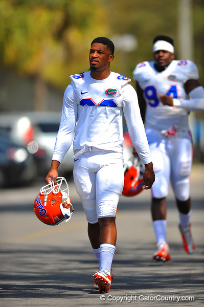 LB Jeremi Powell jogs toward the Gator practice field for spring practice.  Florida Gators Spring Practice 2014.  March 26st, 2014.  Gator Country photo by David Bowie.