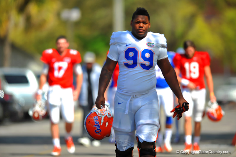 DL Jay-nard Bostwick walks toward the football practice field. Florida Gators Spring Practice 2014.  March 26st, 2014.  Gator Country photo by David Bowie.