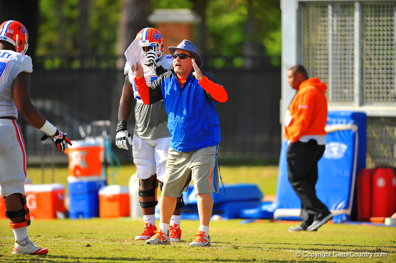 Gator defensive lines coach Brad Lawing coaches up his defensive line during practice.  Florida Gators Spring Practice 2014.  March 26st, 2014.  Gator Country photo by David Bowie.