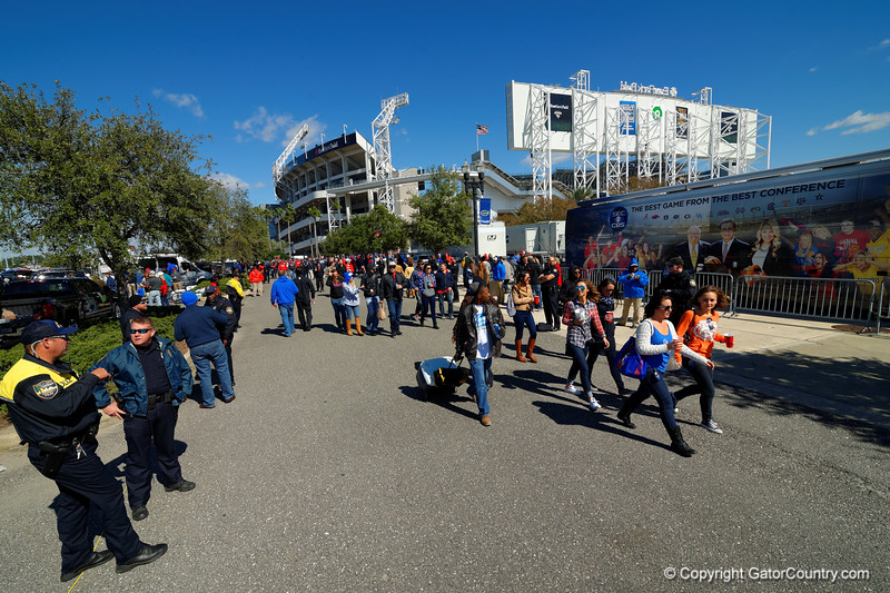 The Florida Gators march into Everbank Field in Jacksonville for their game against the Georgia Bulldogs as the Florida fans cheer them on.  Florida Gators vs Georgia Bulldogs.  November 1st, 2014. Gator Country photo by David Bowie.