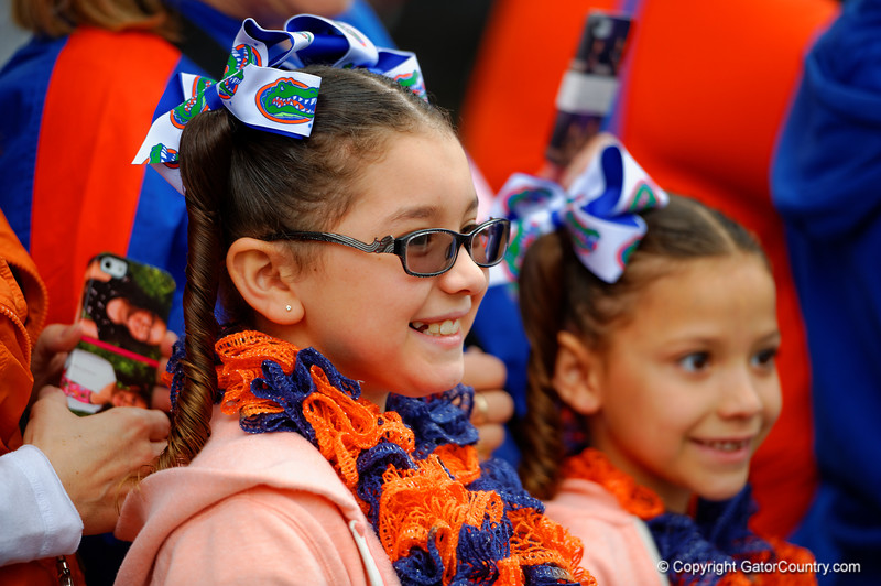 The Florida Gators march into the stadium for their final home game of the season greeting the fans as they enter the stadium.  Florida Gators vs Eastern Kentucky Colonels.  November 22th, 2014. Gator Country photo by David Bowie.