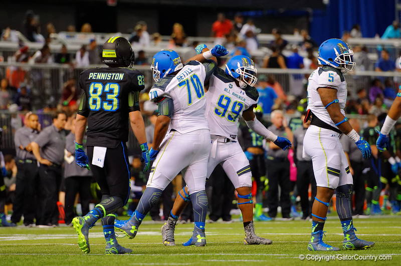 Team Highlight DE Byron Cowart and Team Highlight DT Tim Settle celebrate a third down stop.  2015 Under Armour All-America High School Football Game.  January 2nd, 2015. Gator Country photo by David Bowie.