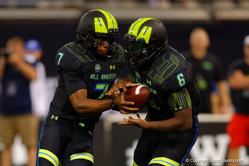 Team Armour QB Brandon Wimbush hands off to Team Armour RB Jacques Patrick.  2015 Under Armour All-America High School Football Game.  January 2nd, 2015. Gator Country photo by David Bowie.