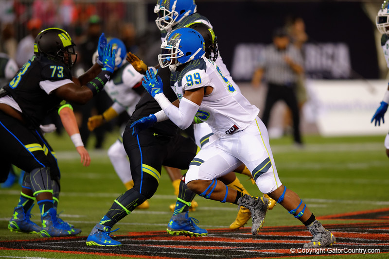 Team Highlight DE Byron Cowart rushes around the outside trying to get to the quarterback.  2015 Under Armour All-America High School Football Game.  January 2nd, 2015. Gator Country photo by David Bowie.
