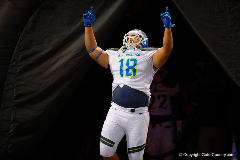 Team Highlight DT Breiden Fehoko runs out during player introductions.  2015 Under Armour All-America High School Football Game.  January 2nd, 2015. Gator Country photo by David Bowie.