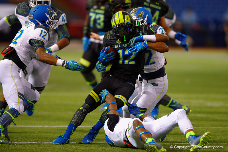 Team Armour WR Christian Kirk is tackled by Team Highlight ILB Jahvoni Simmons.  2015 Under Armour All-America High School Football Game.  January 2nd, 2015. Gator Country photo by David Bowie.