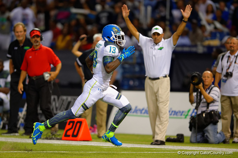 Team Highlight WR Daylon Charlot sprints toward the sideline and into the endzone as head coach Herm Edwards raises his hands into the air to signal the touchdown.  2015 Under Armour All-America High School Football Game.  January 2nd, 2015. Gator Country photo by David Bowie.