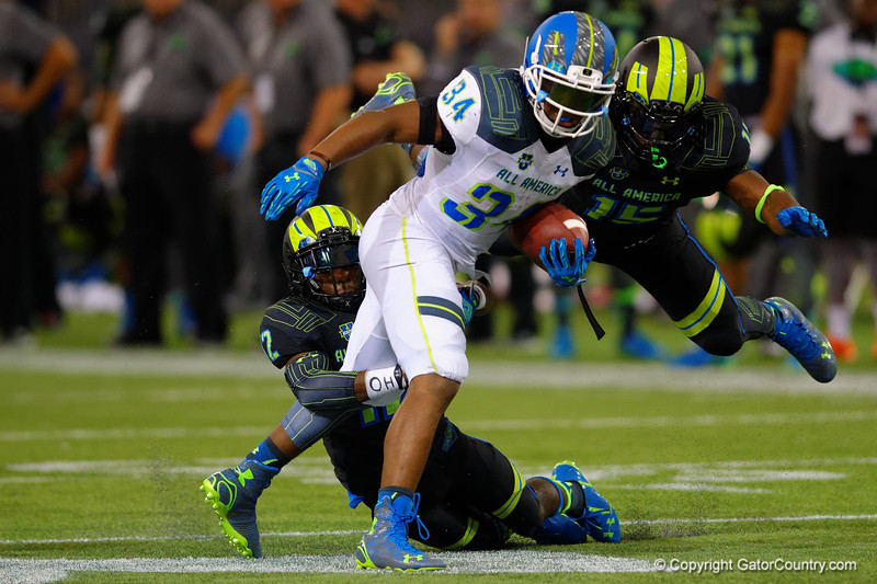 Team Highlight RB Damien Harris is tackled by Team Armour CB Eric Glover-Williams and Team Armour OLB Richard McBryde.  2015 Under Armour All-America High School Football Game.  January 2nd, 2015. Gator Country photo by David Bowie.