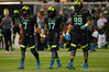 Team Armour QB Brandon Wimbush, Team Armour OLB Te'Von Coney and Team Armour DE Canton Kaumatule walk out hand in hand for the coin toss as captains for Team Armour.  2015 Under Armour All-America High School Football Game.  January 2nd, 2015. Gator Country photo by David Bowie.