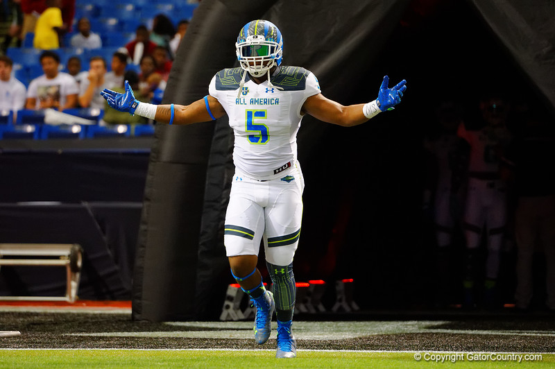 Team Armour OLB Jordan Colbert runs out during player introductions.  2015 Under Armour All-America High School Football Game.  January 2nd, 2015. Gator Country photo by David Bowie.