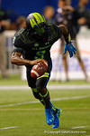 Team Armour QB De'Andre Johnson scrambles out of the pocket and looks downfield for an open receiver.  2015 Under Armour All-America High School Football Game.  January 2nd, 2015. Gator Country photo by David Bowie.