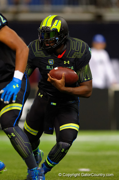 Team Armour RB Jacques Patrick looks upfield for an open hole to rush through.  2015 Under Armour All-America High School Football Game.  January 2nd, 2015. Gator Country photo by David Bowie.