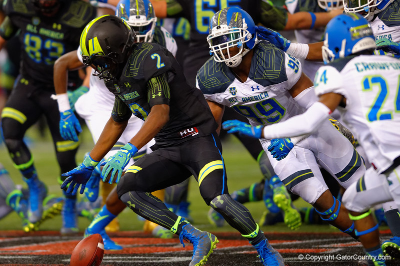 Team Armour RB Soso Jamabo fumbles the ball as Team Highlight DE Byron Cowart comes barreling in towards him.  2015 Under Armour All-America High School Football Game.  January 2nd, 2015. Gator Country photo by David Bowie.