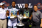 MVP trophy winners, Team Highlight DE Byron Cowart and Team Armour DT Daylon Mack with coaches Herm Edwards and Steve Mariucci.  2015 Under Armour All-America High School Football Game.  January 2nd, 2015. Gator Country photo by David Bowie.
