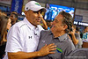 Head coaches Herm Edwards and Steve Mariucci meet after the game and it is all smiles and laughs.  2015 Under Armour All-America High School Football Game.  January 2nd, 2015. Gator Country photo by David Bowie.