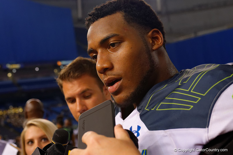 Team Highlight DE Byron Cowart meets with fans, media and family after the game.  2015 Under Armour All-America High School Football Game.  January 2nd, 2015. Gator Country photo by David Bowie.
