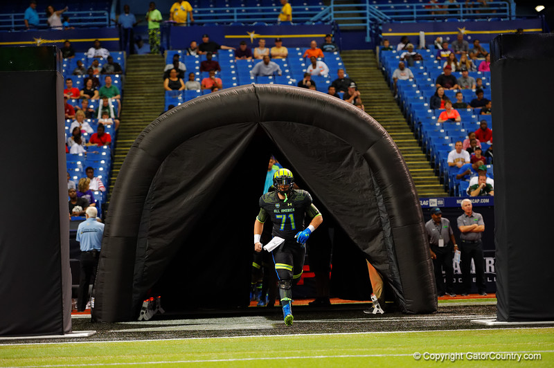 Team Armour OG Tyler Jordan runs out during player introductions.  2015 Under Armour All-America High School Football Game.  January 2nd, 2015. Gator Country photo by David Bowie.