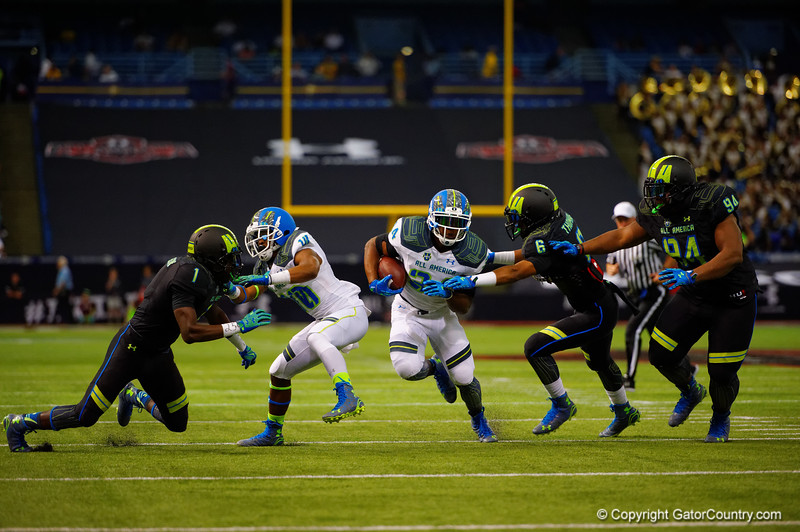Team Highlight RB Damien Harris rushes downfield while Team Armour OLB Adonis Thomas attempts the tackle.  2015 Under Armour All-America High School Football Game.  January 2nd, 2015. Gator Country photo by David Bowie.