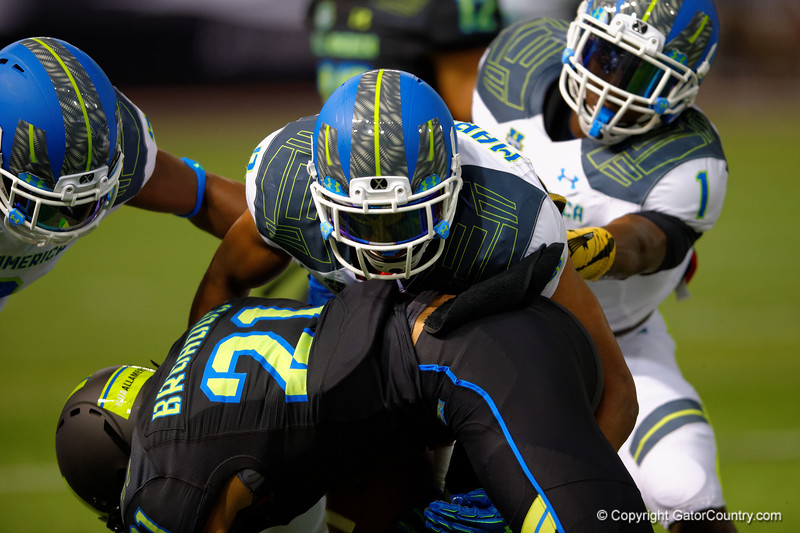 Team Armour WR Cordell Broadus is tackled by Team Highlight CB Iman Marshall.  2015 Under Armour All-America High School Football Game.  January 2nd, 2015. Gator Country photo by David Bowie.