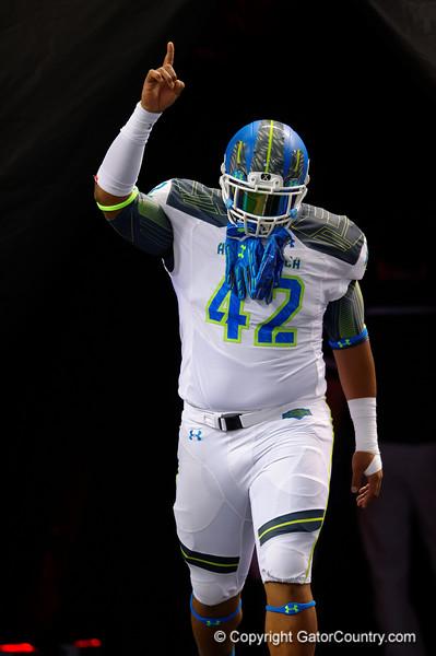 Team Highlight DT Christian Wilkins runs out during player introductions.  2015 Under Armour All-America High School Football Game.  January 2nd, 2015. Gator Country photo by David Bowie.