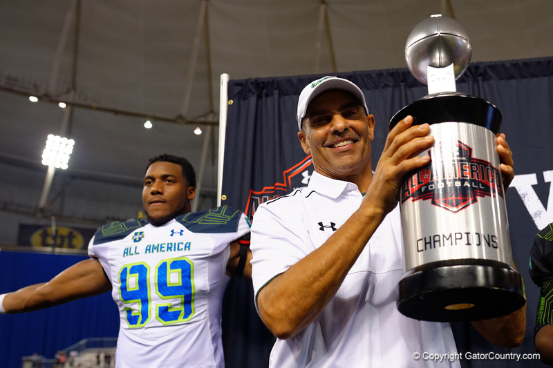 Team Highlight head coach Herm Edwards raises the championship trophy into the air.  2015 Under Armour All-America High School Football Game.  January 2nd, 2015. Gator Country photo by David Bowie.