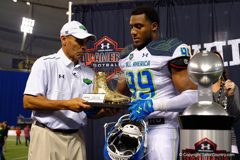 Team Highlight coach congratulates Team Highlight MVP Byron Cowart as he is presented the award.  2015 Under Armour All-America High School Football Game.  January 2nd, 2015. Gator Country photo by David Bowie.