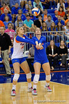 Florida Gators Volleyball players Holly Pole and Abby Detering both get ready to bump a ball during the first set.  Florida Gators Volleyball vs Mississippi State Bulldogs.  October 26th, 2014. Gator Country photo by David Bowie.