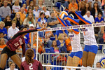 Florida Gator volleyball players Alex Holston and Rhamat Alhassan leap up to block the ball hit by Mississippi State's Alex Warren during the first set.  Florida Gators Volleyball vs Mississippi State Bulldogs.  October 26th, 2014. Gator Country photo by David Bowie.