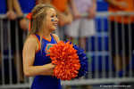 A Florida Gators cheerleader cheers on for the fans during the first intermission.  Florida Gators Volleyball vs Mississippi State Bulldogs.  October 26th, 2014. Gator Country photo by David Bowie.