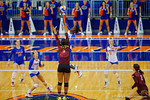 Florida Gators Volleyball player Shainah Joseph leaps way over the Mississippi State's Bali Leffall-Young for the spike and the pointduring the second set of the match.  Florida Gators Volleyball vs Mississippi State Bulldogs.  October 26th, 2014. Gator Country photo by David Bowie.