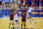 Florida Gators Volleyball player Abby Detering sets the ball to Florida Gators Volleyball player Rhamat Alhassan who spikes it for the final point to win the match.  Florida Gators Volleyball vs Mississippi State Bulldogs.  October 26th, 2014. Gator Country photo by David Bowie.