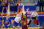 Florida Gators Volleyball player Ziva Recek leaps over Mississippi State's Leticia Valente for the kill during the third set in the match.  Florida Gators Volleyball vs Mississippi State Bulldogs.  October 26th, 2014. Gator Country photo by David Bowie.