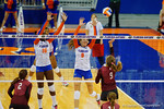 Florida Gators Volleyball player Ziva Recek and Simone Antwi attempt the block on the hit by Mississippi State's Leticia Valente during the third set in the match.  Florida Gators Volleyball vs Mississippi State Bulldogs.  October 26th, 2014. Gator Country photo by David Bowie.