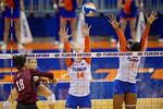 Florida Gators Volleyball players Abby Detering and Rhamat Alhassan attempt the block on the ball hit by Mississippi State's Alex Warren during the third set in the match.  Florida Gators Volleyball vs Mississippi State Bulldogs.  October 26th, 2014. Gator Country photo by David Bowie.