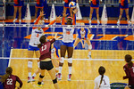 Florida Gators Volleyball players Alex Holston and Simone Antwi attempt the block on the hit by Mississippi State's Chelsea Duhs during the third set in the match.  Florida Gators Volleyball vs Mississippi State Bulldogs.  October 26th, 2014. Gator Country photo by David Bowie.