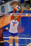Florida Gators Volleyball player Mackenzie Dagostino leaps up for a blockduring the second set of the match.  Florida Gators Volleyball vs Mississippi State Bulldogs.  October 26th, 2014. Gator Country photo by David Bowie.