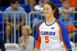 Florida Gators Volleyball player Taylor Unroe flashes a smile as she walks onto the court for the start of the match.   Florida Gators Volleyball vs Mississippi State Bulldogs.  October 26th, 2014. Gator Country photo by David Bowie.