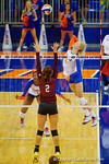 Florida Gators Volleyball player Carli Snyder leaps up for the killduring the second set of the match.  Florida Gators Volleyball vs Mississippi State Bulldogs.  October 26th, 2014. Gator Country photo by David Bowie.