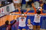 Florida Gators Volleyball players Alex Holston and Rhamat Alhassan leap up for the blockduring the second set of the match.  Florida Gators Volleyball vs Mississippi State Bulldogs.  October 26th, 2014. Gator Country photo by David Bowie.