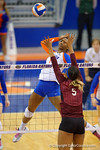 Florida Gators Volleyball player Rhamat Alhassan leaps up for the spike and point during the third set in the match.  Florida Gators Volleyball vs Mississippi State Bulldogs.  October 26th, 2014. Gator Country photo by David Bowie.