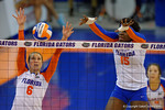 Florida Gators Volleyball players Mackenzie Dagostino and Shainah Joseph leap up for a blockduring the second set of the match.  Florida Gators Volleyball vs Mississippi State Bulldogs.  October 26th, 2014. Gator Country photo by David Bowie.