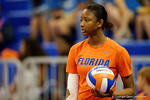 Florida Gators Volleyball player Rhamat Alhassan during pre-game warm ups. Florida Gators Volleyball vs Mississippi State Bulldogs.  October 26th, 2014. Gator Country photo by David Bowie.
