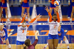Florida Gators Volleyball player Alex Holston and Rhamat Alhassan attempt the block on the ball hit by Mississippi State during the third set in the match.  Florida Gators Volleyball vs Mississippi State Bulldogs.  October 26th, 2014. Gator Country photo by David Bowie.