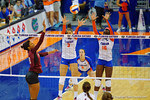 Florida Gators Volleyball players Alex Holston and Simone Antwi jump up for the block on the Mississippi State's hit.  Florida Gators Volleyball vs Mississippi State Bulldogs.  October 26th, 2014. Gator Country photo by David Bowie.